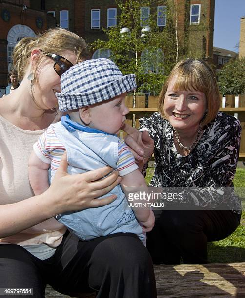 The Labour Party's prospective parliamentary candidate for Camberwell and Peckham Harriet Harman meets with mothers and babies during a visit...