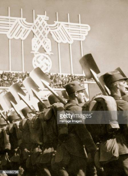 The Labour Service ready for work Germany 1936 Uniformed members of the Labour Service line up with their shovels in front of crowds of people From...