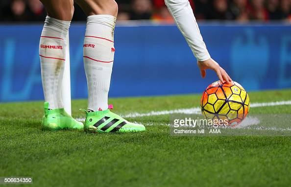 The laceless adidas boots of Mesut Ozil of Arsenal as he prepares to take a corner during the Barclays Premier League match between Arsenal and...