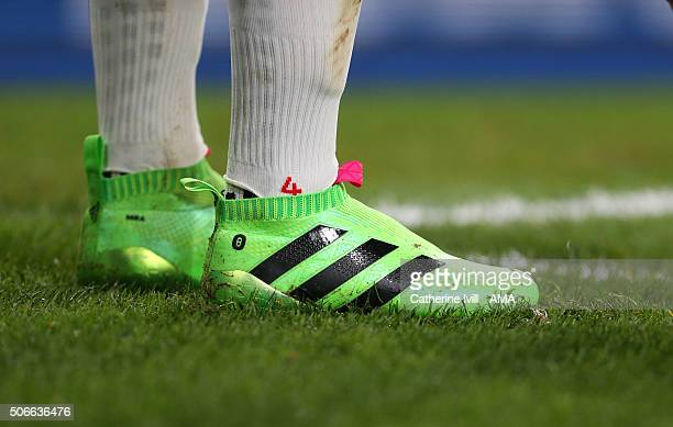 The laceless Adidas boots of Mesut Ozil of Arsenal during the Barclays Premier League match between Arsenal and Chelsea at the Emirates Stadium on...