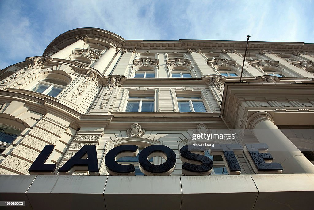 The Lacoste logo sits outside a retail store operated by Lacoste SA in Berlin, Germany, on Thursday, April 18, 2013. Germany's economy is shrugging off a contraction at the end of last year and starting to grow due to revived exports and rising private consumption, the country's leading economic institutes said. Photographer: Krisztian Bocsi/Bloomberg via Getty Images