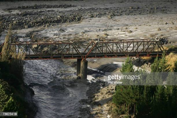 The Lahar flows under the Tangiwai Rail Bridge as it makes its way along the path of the Whangaehu River after breaking the crater wall on Mount...