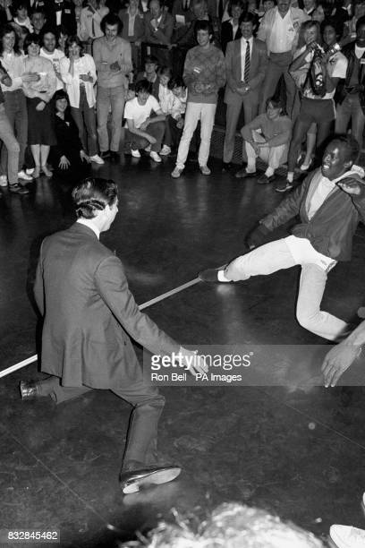 The laid back Prince of Wales teams up with a youngster for a breakdancing session at a discotheque at MiddletononSea during his visit to a Youth...