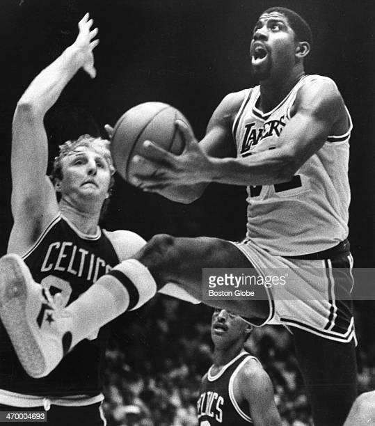 The Lakers' Magic Johnson drives past the Celtics' Larry Bird in third quarter action as the Boston Celtics platt the Los Angeles Lakers at Boston...