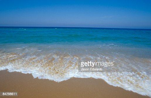 A deep blue sea and crisp waves lap the shoreline of the 90 Mile Beach