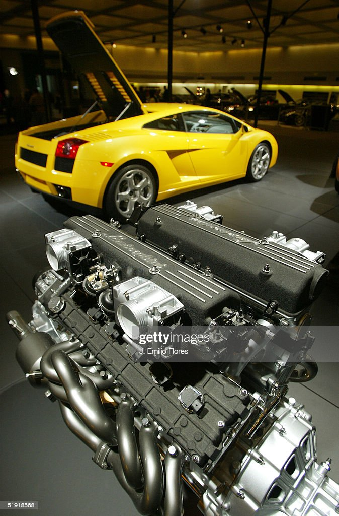The Lamborghini Murcielago engine stands on display in the foreground with the Lamborghini Gallardo in background at the 2005 Los Angeles Auto Show January 5, 2005 in Los Angeles, California.