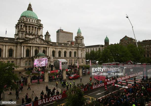 The LampreMerida team cross the finish at Belfast City Hall during the Team Time Trial in stage one of the 2014 Giro D'Italia