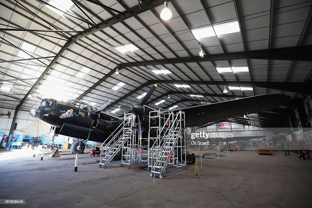The Lancaster bomber 'Just Jane', which is being restored with the aim of getting it airworthy, is parked in a hangar at Lincolnshire Aviation Heritage Centre on February 14, 2013 in East Kirkby, England. The plane, which last flew in 1971, would become one of only three airworthy Lancaster bombers in the world. Brothers Fred and Harold Panton, owners of the Lincolnshire Aviation Heritage Centre, are restoring the plane in memory of their sibling, Christopher Panton, who died aged 19 when his Lancaster was shot down in 1944.