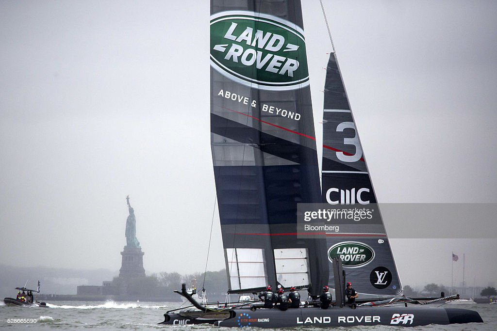 The Land Rover Ben Ainslie Racing catamaran sails past the Statue of Liberty during practice for the Louis Vuitton America's Cup World Series sailing races in New York, U.S., on Friday, May 6, 2016. The America's Cup sailing races are held in New York City on the Hudson River for the first time since 1920. Photographer: Michael Nagle/Bloomberg via Getty Images