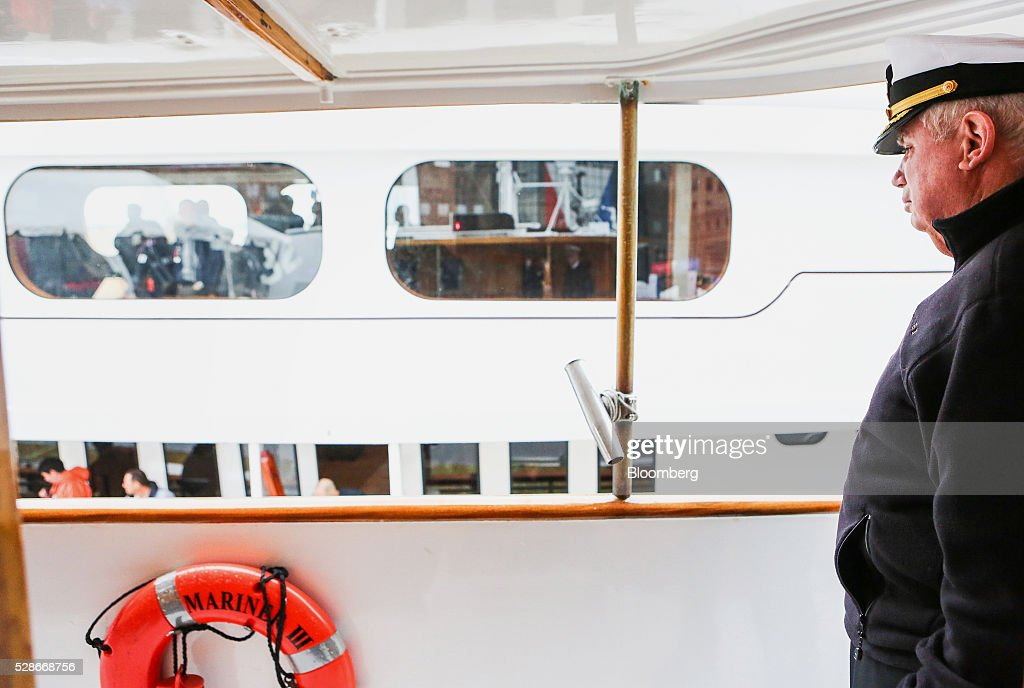 The Land Rover hospitality boat Captain greets spectators coming aboard ahead of the Louis Vuitton America's Cup World Series races in New York, U.S., on Friday, May 6, 2016. The America's Cup sailing races are held in New York City on the Hudson River for the first time since 1920. Photographer: Chris Goodney/Bloomberg via Getty Images