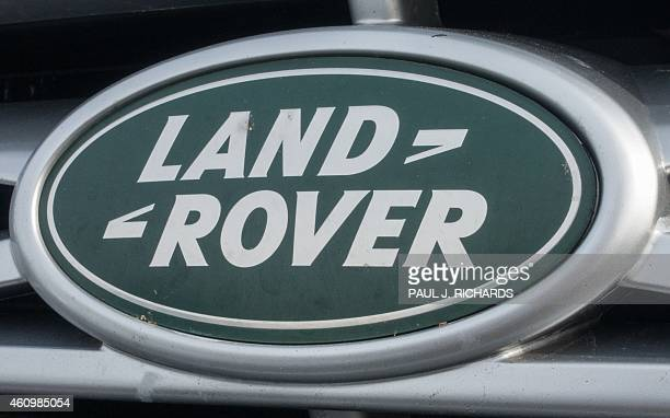 land rover logo 2015. the landrover logo is seen on a parking lot in sterling virginia january 2 2015 land rover