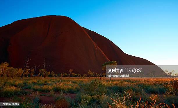 The Landscape Of Uluru At Dawn