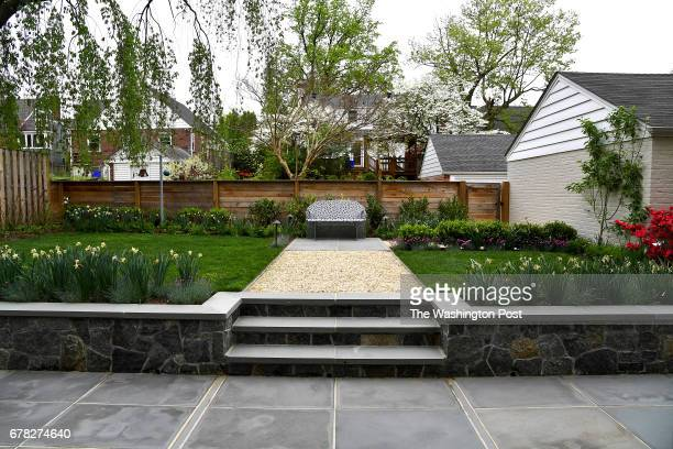 The landscaped backyard of Bruce Marshall and Amy Dibner's home has dining and seating areas April 19 2017 in Silver Spring MD