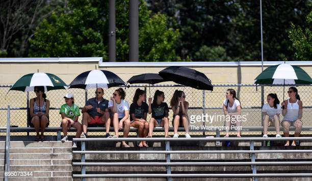 CHANTILLY VA JUNE The Langley Saxons fans keep cool with umbrellas during the Virginia 6A Boy's Soccer State Championship game at Westfield High...