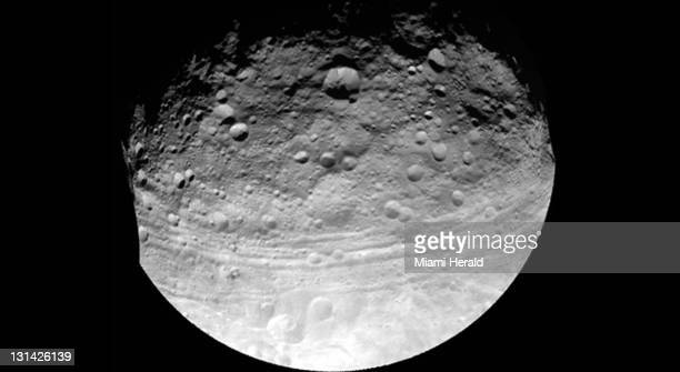 The large asteroid Vesta is shown in this image taken by NASA's Dawn spacecraft Astronauts and scientists are training in waters off Key Largo...