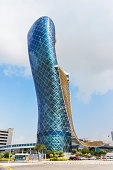 ABU DHABI, UAE - NOVEMBER 5: The Capital Gate Tower on the November 5, 2013 in Abu Dhabi, This is certified as the World's Furthest Leaning Manmade in the world. it is in the heart of the business are