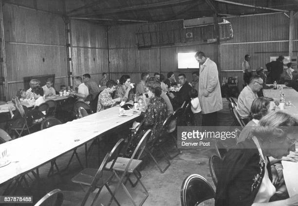 The large crowd of flying participants enjoys the breakfast in the hangar at Crosson Field in Sterling Colo after flying to the site from many parts...