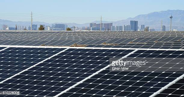 The Las Vegas Strip is shown behind solar panels during a dedication ceremony to commemorate the completion of the 102acre 15megawatt Solar Array II...