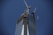 The last 75foot section of the 408foot spire is hoisted onto a temporary platform on the top of One World Trade Center on May 2 2013 in New York City...