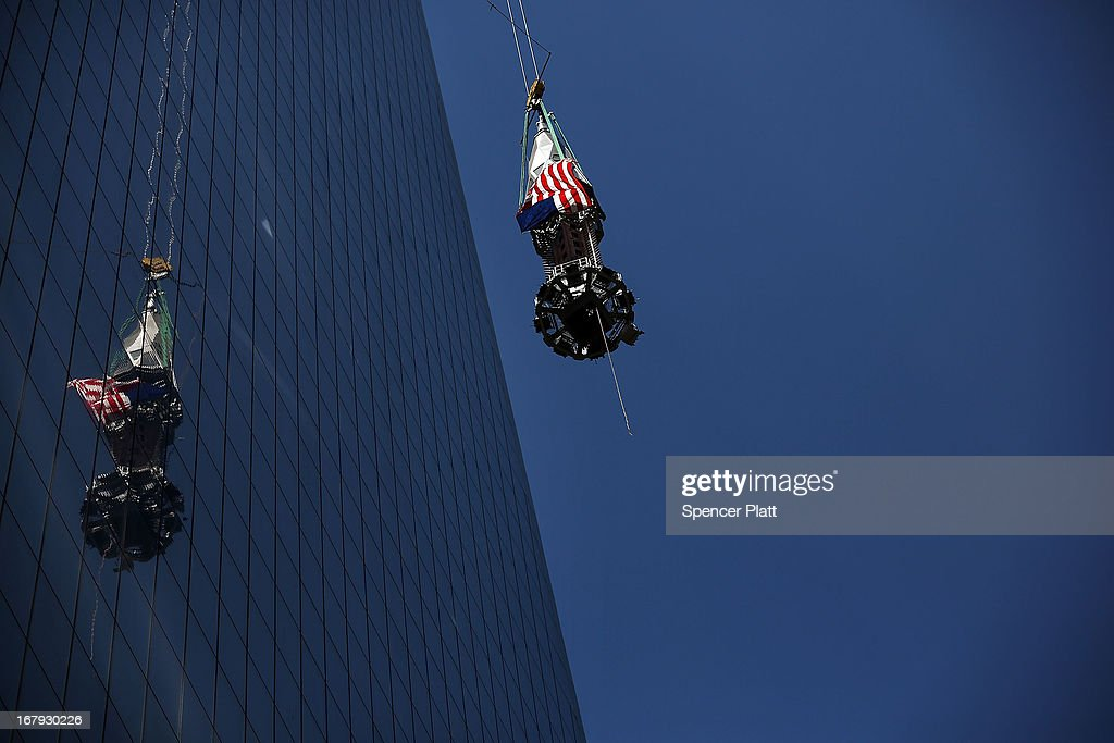 The last 75-foot section of the 408-foot spire is hoisted onto a temporary platform on the top of One World Trade Center on May 2, 2013 in New York City. When bolted into place at a later date, the spire will make One World Trade Center the tallest building in the Western Hemisphere.The raising of the spire, which comes on the second anniversary of the death of Osama bin Laden, will make One World Trade Center 1,776 feet tall. One World Trade Center is built on the site where the September 11, 2001 attacks toppled the original World Trade Center towers.