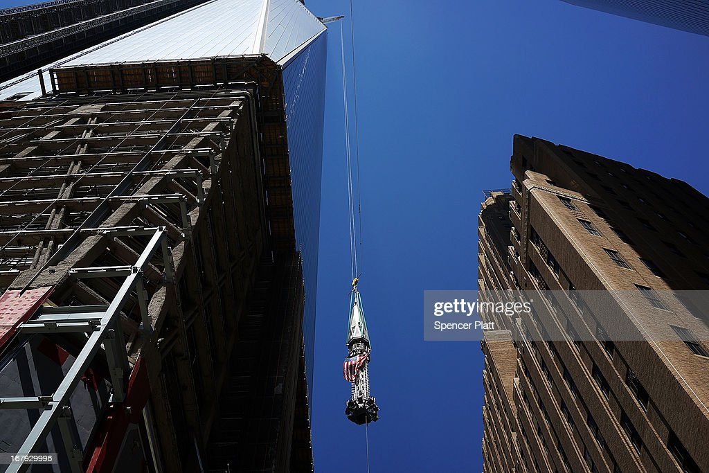 The last 75-foot section of the 408-foot spire is viewed as it is hoisted onto a temporary platform on the top of One World Trade Center on May 2, 2013 in New York City. When bolted into place at a later date, the spire will make One World Trade Center the tallest building in the Western Hemisphere.The raising of the spire, which comes on the second anniversary of the death of Osama bin Laden, will make One World Trade Center 1,776 feet tall. One World Trade Center is built on the site where the September 11, 2001 attacks toppled the original World Trade Center towers.