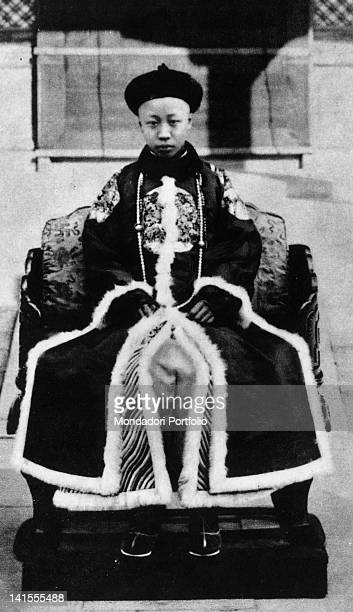 The last emperor of China Pu Yi sitting on the throne at the age of eleven China 1917