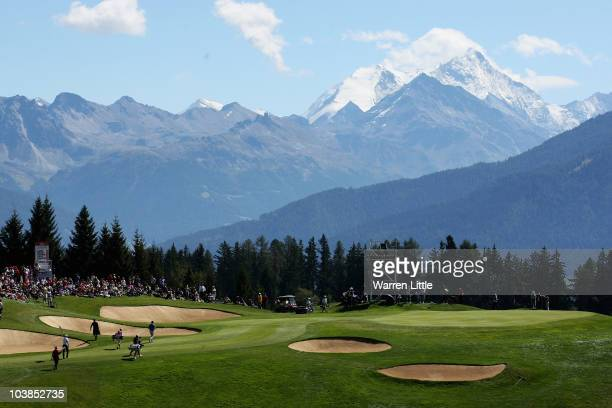The last group approaches the seventh green during the final round of The Omega European Masters at CransSurSierre Golf Club on September 5 2010 in...