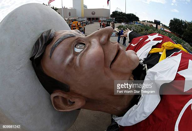 The last horizontal moments for Big Tex before a crane hoists him into place with the State Fair of Texas one week away from opening at the Midway in...