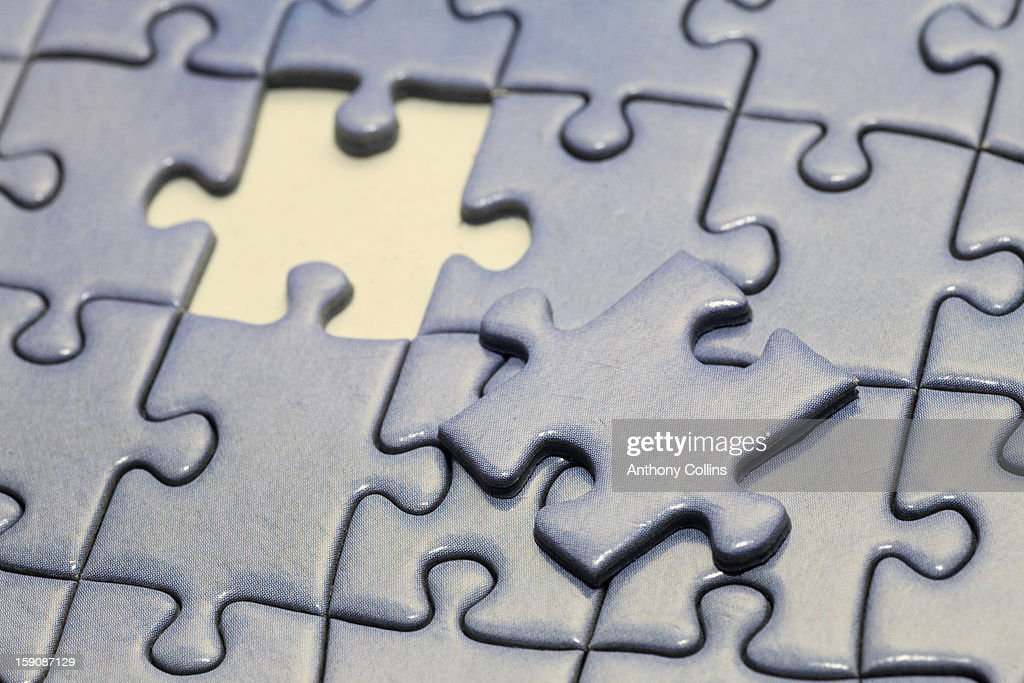 The last piece of a jigsaw puzzle : Stock Photo