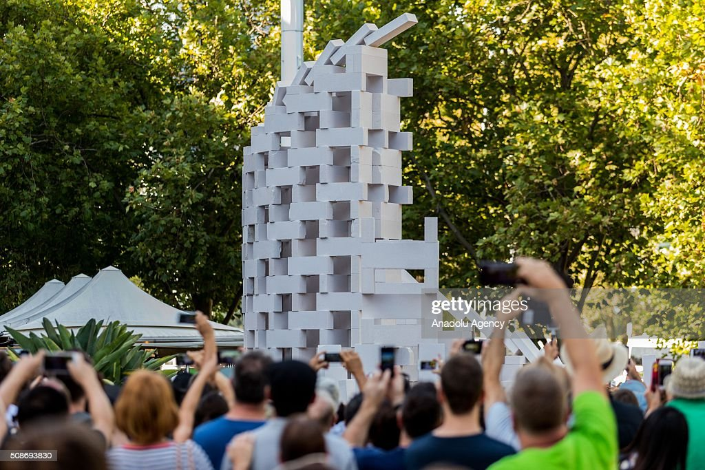 The last piece of the large domino set falls off during the Arts Centre Melbournes Dominoes arts project in Melbourne, Australia February 6, 2016. More than 7000 giant dominoes snaked through Melbourne city over 2km.