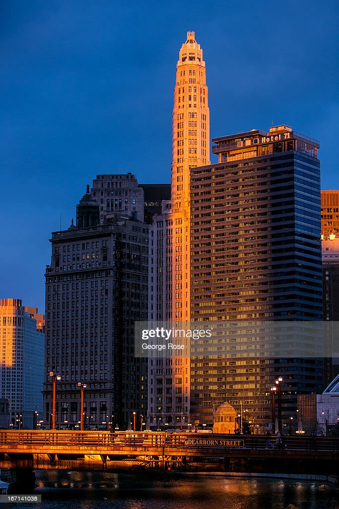 The last rays of sunlight at sunset hit the Dearborn Street Bridge and downtown highrises on March 26, 2013, in Chicago, Illinois. Visitors to 'The Windy City,' the third most populous city in the United States, have had to bundle up due to an unusually cold spring.