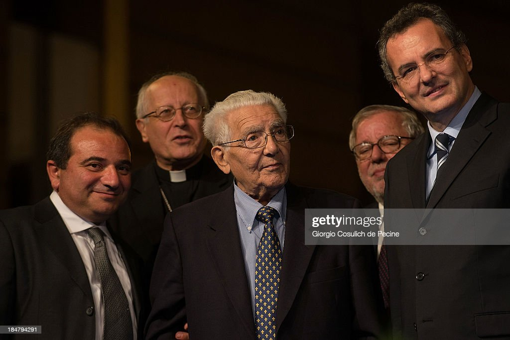 The last Roman Jew survived to the Nazi raid of 1943, Nello Di Segni (C) attends the commemoration of the 70th anniversary of the deportation of Roman Jews on October 16, 2013 in Rome, Italy. On October 16, 1943, Nazi troops invaded the streets of Portico d'Ottavia, in the Jewish ghettos of Rome, and took 1,024 people, including more than 200 children, who were later destined for the concentration camps of Auschwitz. Only fifteen men and one woman returned home from Poland.