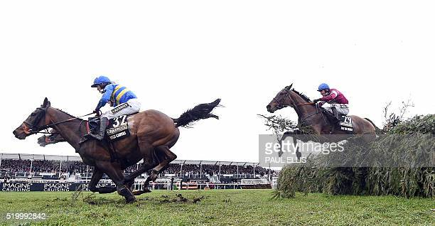 The Last Samuri Vics Canvas and Rule the World ridden by David Mullins jump the final fence during the Grand National at Aintree Racecourse in...