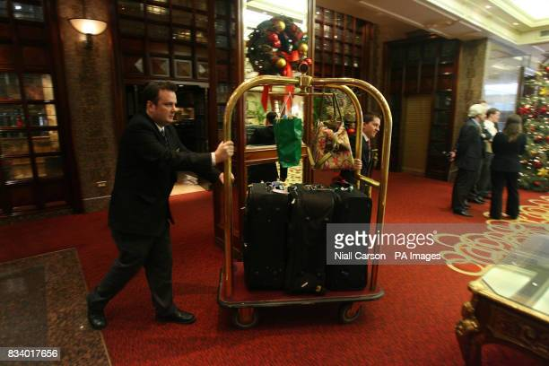 The last trolley of luggage is removed from the Burlington Hotel in Dublin as it closes its doors for the last time today
