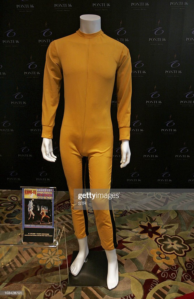The late actor Bruce Lee's stunt double iconic yellow jumpsuit from the film 'Game Of Death', filmed in 1972 and released in 1978, is displayed at a media preview of pop memorabilia in Macau on August 18, 2010. The items are among several hundred pieces of memorabilia -- including an unused ticket to the iconic Woodstock music festival, Marilyn Monroe's bra, Elvis Presley's hair and a gown that belonged to Princess Diana -- that will go under the hammer at the October 9, 2010 auction in the glitzy Asian gambling hub.