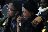The late Gugu Zulus wife Letshego breaks down during her husbands memorial service at the Kyalami Racetrack on July 26 2016 in Johannesburg South...