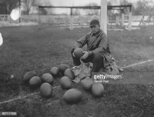 The late Harry Hughes Sits Amid his Favorite SurroundingsFootballs and Goal PostsAt Practice Credit The Denver Post