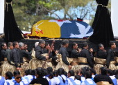 The late King George Tupou V is carried to the Royal Tomb during the State Funeral held for King George Tupou V at Mala'ekula on March 27 2012 in...