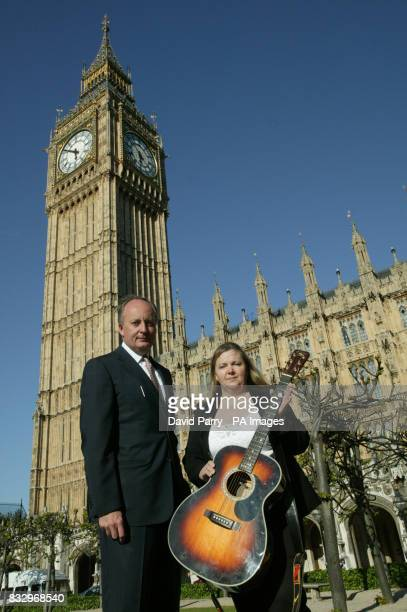 The late Lonnie Donehgan's wife Sharon Donegan with one of Lonnie's famous guitars meets Shaun Woodward MP at The Houses of Parliament