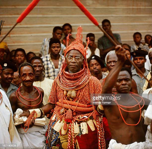 The late Oba Akenzua II in full regalia including a coral garment and headpiece Coral is an important symbol of the identity of the Oba ruler of the...
