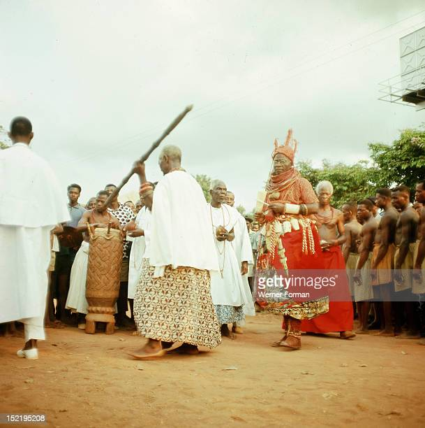 The late Oba Akenzua II in full regalia with members of his court The Oba is obliged to appear in public for a number of important annual rituals...