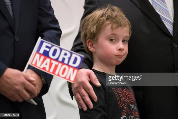 TORONTO ON MARCH 22 The late Rob Ford's son Doug is comforted by Rob's brother Doug as Councillor Giorgio Mammoliti holds a Ford Nation flag onstage...