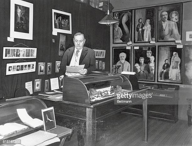 The late Sir Arthur Conan Doyle one of the world's most famous spiritualists as he appeared in his study surrounded by photographs and miscellaneous...