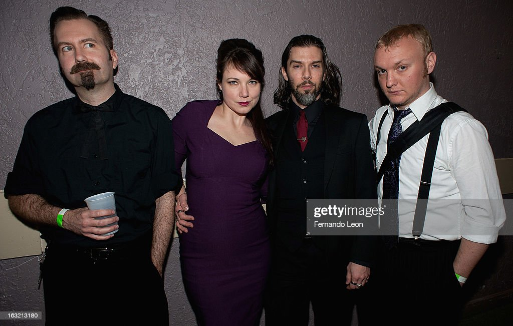 The Latenight Callers, guitarist Krystof Nemeth, singer Julie Berndsen, bassist Gavin Mac and keyboardist Nick Combs pictured backstage during the Friends of JJ's benefit concert at Uptown Theatre on March 5, 2013 in Kansas City, Missouri.