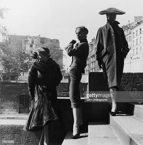 The latest fashion silhouettes are represented here in Paris characterised by the forms of the letters A S and H 4th September 1954 Original...