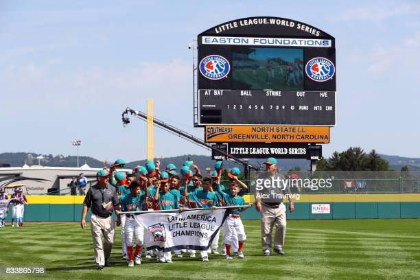 The Latin America team from LuzMaracaibo LL in Maracaibo Venezuela takes the field during the Opening Ceremonies of the 2017 Little League World...