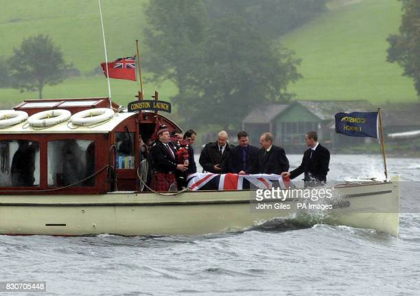 The launch carrying the coffin of powerboat ace Donald Campbell on Lake Coniston in Cumbria where his body was being taken on one last trip around...