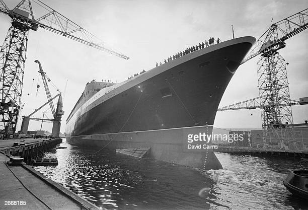 The launch of the new Cunard flagship Queen Elizabeth II from the Upper Clyde Shipbuilders yard Clydebank The QE2 as she became known was the last...