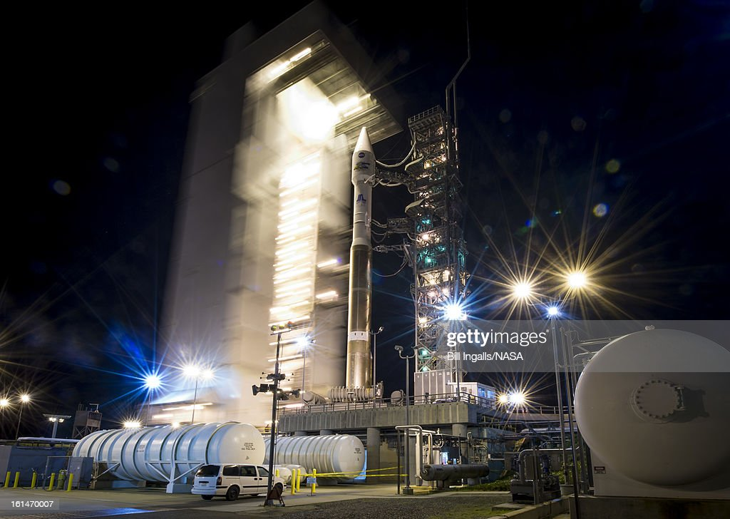 The launch pad tower at SLC-3 is rolled back to reveal the United Launch Alliance (ULA) Atlas-V rocket with the Landsat Data Continuity Mission (LDCM) spacecraft onboard on February 11, 2013 at Vandenberg Air Force Base, California. The Landsat Data Continuity Mission (LDCM) mission is a collaboration between NASA and the U.S. Geological Survey that will continue the Landsat Program's 40-year data record of monitoring the Earth's landscapes from space.