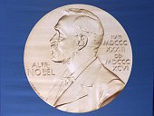 The laureate medal featuring the portrait of Alfred Nobel is seen before a press conference of the Nobel Committee to announce the winner of the 2015...